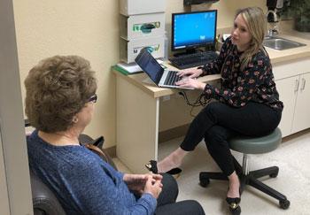 Kirsten R. Furl, B.S.N., M.S.N., FNP talking to a patient