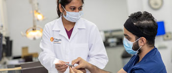 "In August 2020, Poornima ""Nima"" Mensinkai, Ph.D., assistant professor/clinical of comprehensive dentistry, discusses the new Bien Air handpieces distributed to first-year students."