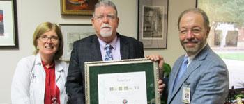 Robin Brey, M.D., former School of Medicine Dean Francisco González-Scarano, M.D., honor John Doran, M.D., FACP
